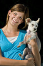 Pretty teenage girl holding her dog Royalty Free Stock Photos