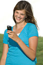 Pretty teenage girl reading text message Stock Photos