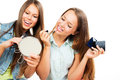 Pretty teenage girls applying make up and looking in the mirror Royalty Free Stock Photography