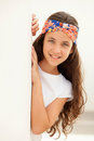 Pretty teenager girl with a flowered headband outdoor Stock Image