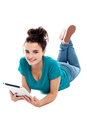 Pretty teenager watching movie on tablet pc Royalty Free Stock Photo