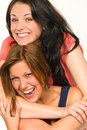 Pretty teens laughing and smiling at camera portrait of Stock Photo