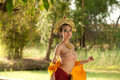 Pretty Thai woman posing in Thai ancient dress . Stock Photos