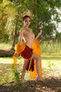 Pretty Thai woman posing in Thai ancient dress . Royalty Free Stock Photo