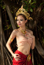 Pretty Thai woman posing in Thai ancient dress . Royalty Free Stock Images