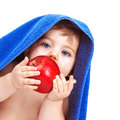 Pretty toddler eating apple closeup portrait of adorable wrapped in blue towel isolated on white background baby boy biting red Royalty Free Stock Image