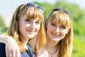Pretty twins girls having fun at outdoor summer park Royalty Free Stock Photo