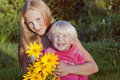 A pretty two sister (age 2 and 12)  in garden Stock Image