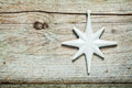 Pretty white Christmas star on old wood Royalty Free Stock Photo