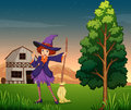 A pretty witch at the farm Stock Photo