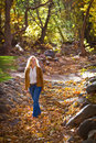 Pretty Woman in Autumn leaves Royalty Free Stock Photography