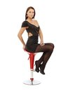 Pretty woman on barstool Royalty Free Stock Image