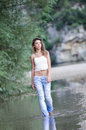 Pretty woman in the beautiful scenery at the river