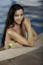 Pretty woman in bikini standing in pool look looking at camera Royalty Free Stock Photos