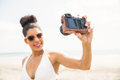 Pretty woman in bikini taking selfie at the beach Royalty Free Stock Photos