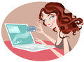 Pretty woman browsing internet her laptob holding credit card Royalty Free Stock Photo