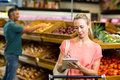 Pretty woman checking grocery list Royalty Free Stock Photo