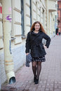 Pretty woman in the city streets Stock Photography