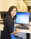 Pretty Woman in Computer Lab Royalty Free Stock Photo