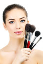 Pretty woman with cosmetic brushes white background Royalty Free Stock Photo