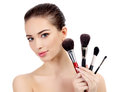 Pretty woman with cosmetic brushes white background copyspace Royalty Free Stock Photo
