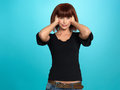 Pretty woman covering her ears Stock Photos