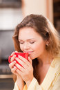 Pretty woman with a cup Royalty Free Stock Image