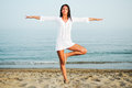 Pretty woman doing yoga on the beach portrait of a Royalty Free Stock Image