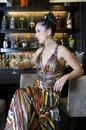 Pretty woman drinking in a bar Royalty Free Stock Photo