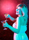 Pretty woman drinking cocktail in nightclub Stock Photography