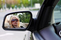 Pretty woman driving her convertible sports car with her sunglasses Stock Photography