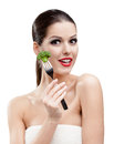 Pretty woman eating broccoli on fork Royalty Free Stock Photography