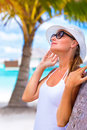 Pretty woman enjoying summer vacation portrait of wearing white hat and sunglasses bright sun light happy holidays tropical resort Stock Photo