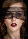 Pretty Woman Face With Net Looking at the Camera Royalty Free Stock Photo