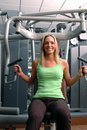 Pretty woman in fitness center Stock Images