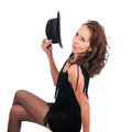 Pretty woman flapper dressed in s style as a with a fedora wearing fish net stockings Stock Image