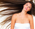 Pretty woman with flying hair Stock Photos