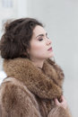 Pretty woman fur coat reverie serene Stock Photos