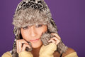 Pretty woman in fur trimmed winter hat Royalty Free Stock Photography