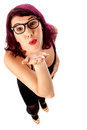 Pretty woman giving you a flying kiss trendy puckering full length shot Stock Photos
