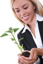 Pretty Woman and Growth Plant Stock Photo