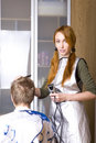 Pretty woman hairdresser Royalty Free Stock Photo