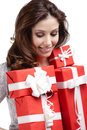 Pretty woman hands a number of presents wrapped in red gift paper isolated on white Royalty Free Stock Image