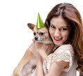 Pretty woman hands a straw-colored small dog Royalty Free Stock Image