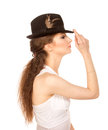 Pretty woman in hat with bird s feather isolated Stock Images
