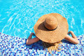 Pretty woman hat enjoying swimming pool Royalty Free Stock Photos
