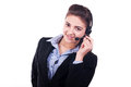Pretty woman headset smiling telephone conversation Royalty Free Stock Images