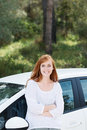 Pretty woman with her new car posing looking at the camera folded arms Royalty Free Stock Images