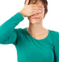 Pretty woman hides her eyes Stock Image