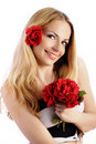 Pretty woman holding a bouquet of roses Stock Images